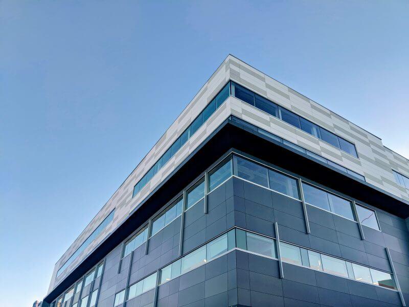 Modern angular office block against a blue sky